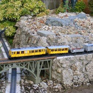 Bernina Railway railcar in original livery and train